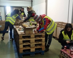 Sort out donated food for people in need in February