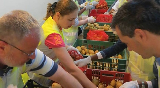 Sort out donated food for people in need in December