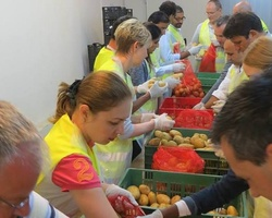 Sort out donated food for people in need in March